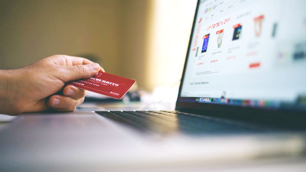 shopping online, holding credit card