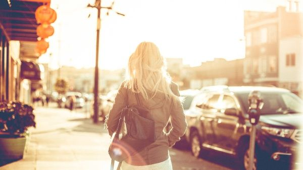 young girl walking down the street listlessly