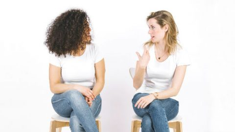 two women talking and sitting