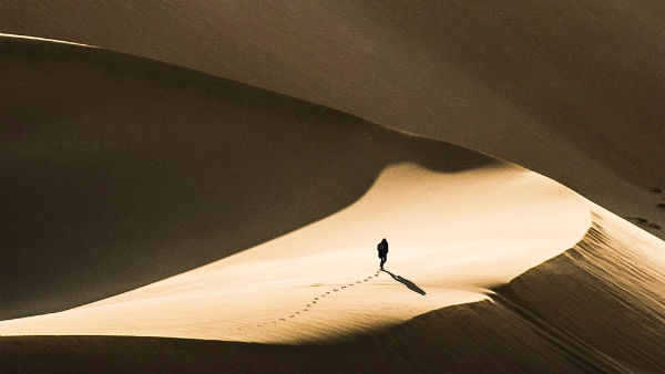 a man walking in the desert alone