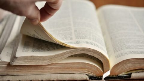 hand open bible book