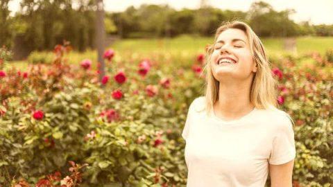 Beautiful woman enjoying the air in the garden