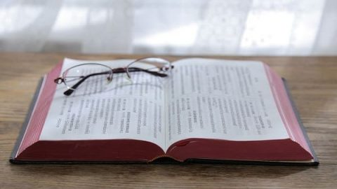 A pair of glasses and the bible