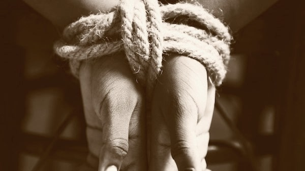 Kidnapped, tied hands with rope