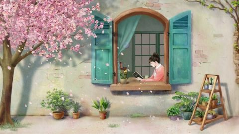 A girl is reading at the window